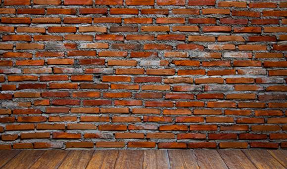A brick wall - symbolism of a deal breaker.