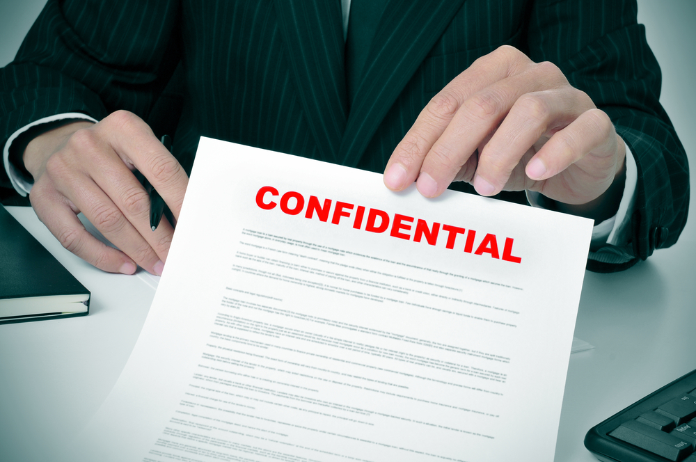 A business executive presents a confidentiality agreement.