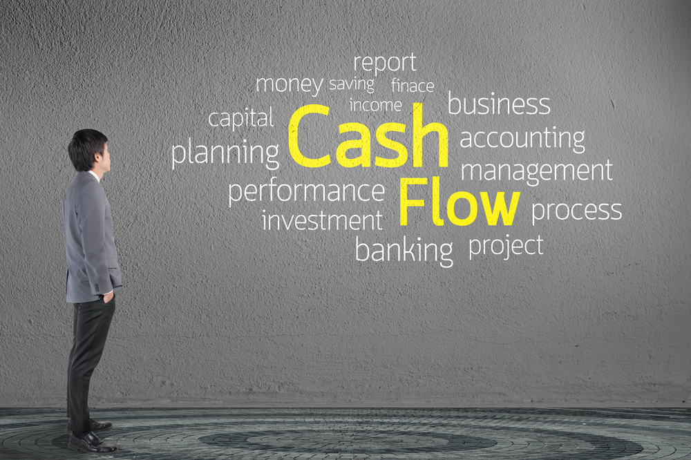 An entrepreneur contemplating the cash flow of his entity.