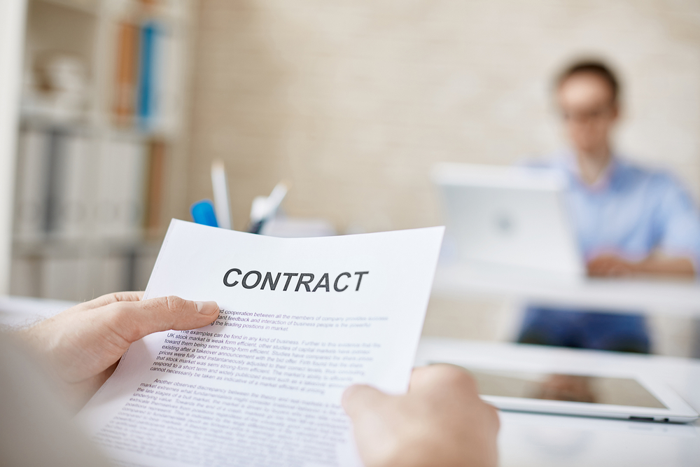An investor looking at a business contract.