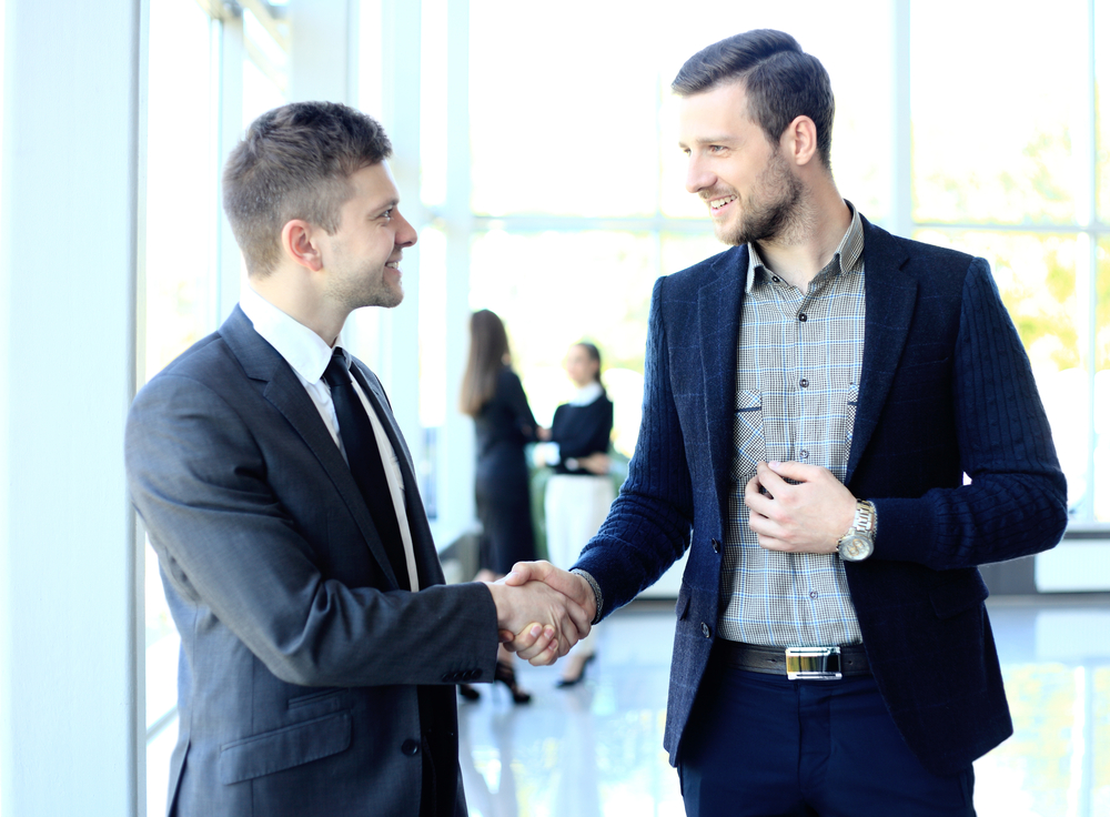 Two businessmen meeting before a business walk through.