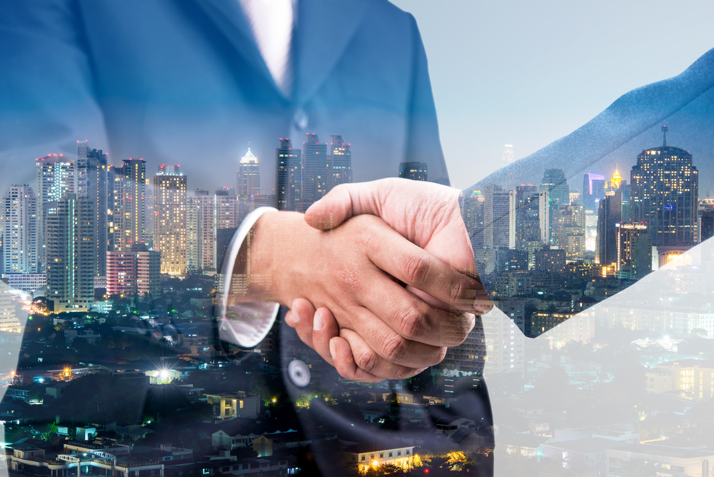 Two business partners shaking hands on a deal.