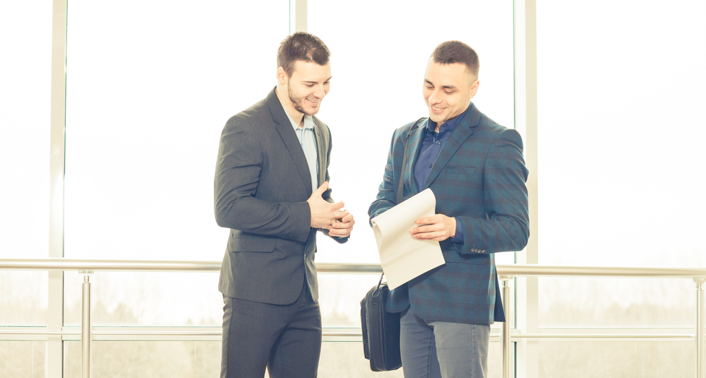 A business buyer and seller negotiating a deal.