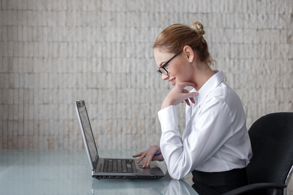 A businesswoman doing research on the how-tos before purchasing a new entity.