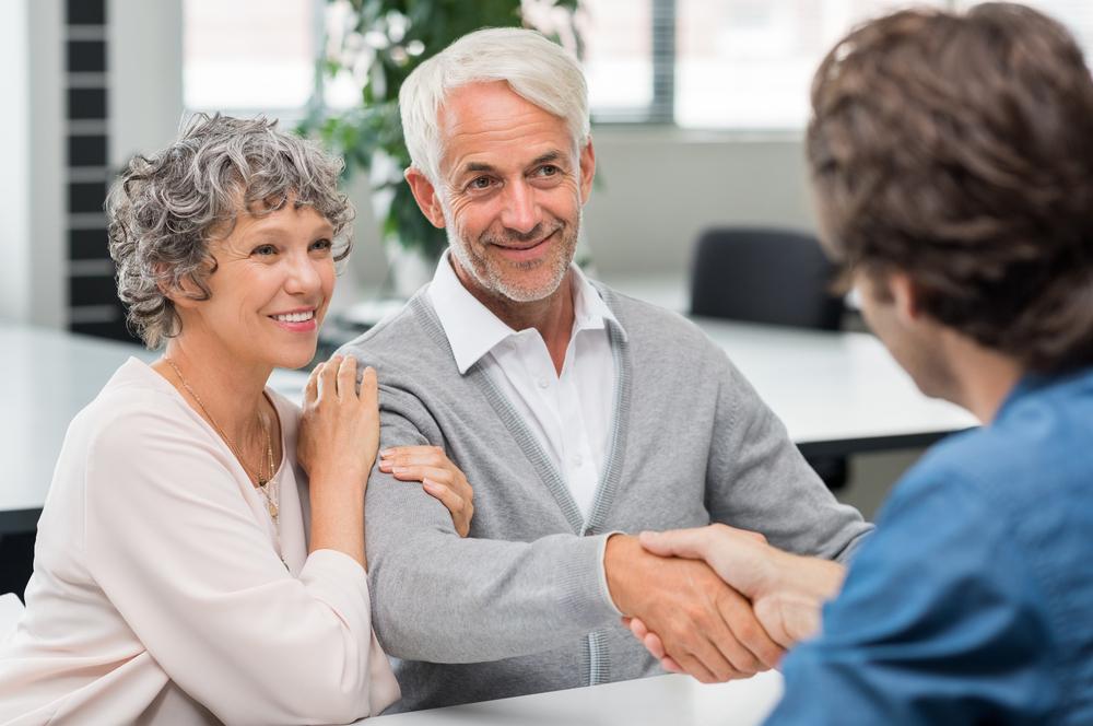 Older businessman discussing investment plans.
