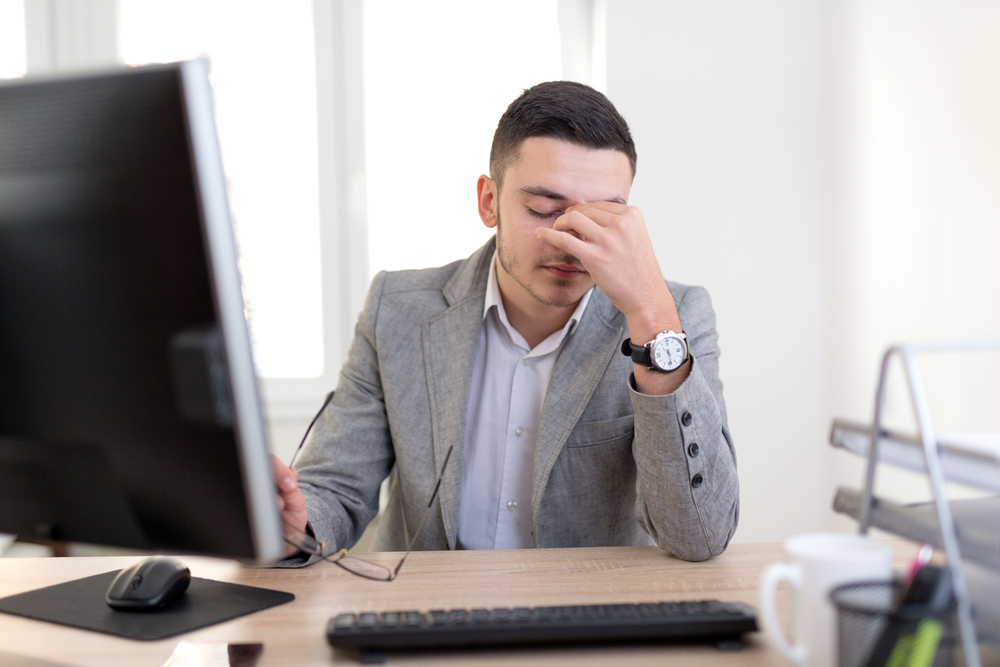 Frustrated Businessman who cannot get Information from Broker.