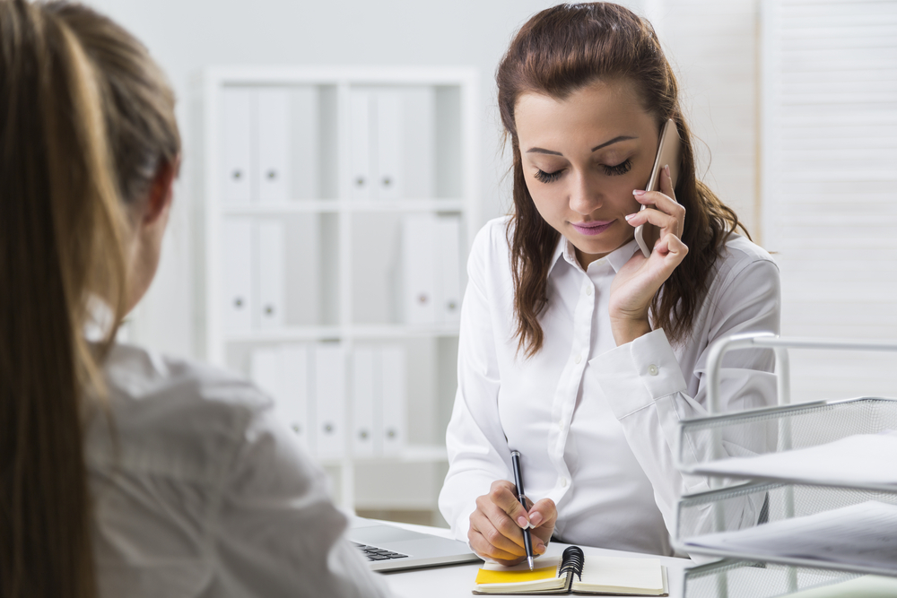 Business Woman and Employee Discussing Employee's Issues.