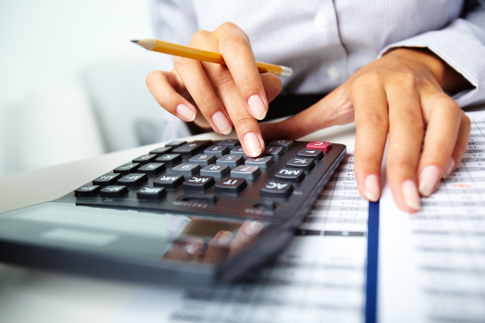 An entrepreneur calculating the amount of money they would need to make a business investment.